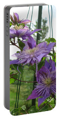 Portable Battery Charger featuring the photograph Double Clematis Named Crystal Fountain by J McCombie