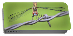 Portable Battery Charger featuring the photograph Dragonfly On Barbed Wire by Penny Meyers