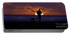 Portable Battery Charger featuring the photograph Evening Run On The Beach by Clayton Bruster
