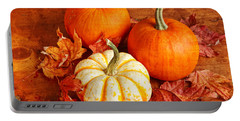Portable Battery Charger featuring the photograph Fall Pumpkins And Decorative Squash by Verena Matthew