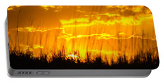 Portable Battery Charger featuring the photograph Firey Sunset by Shannon Harrington