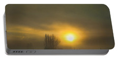 Foggy Sunrise Portable Battery Charger by Charlie Duncan