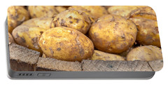 Freshly Harvested Potatoes In A Wooden Bucket Portable Battery Charger by Tom Gowanlock