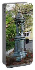 Portable Battery Charger featuring the photograph Garden Statuary In The French Quarter by Alys Caviness-Gober