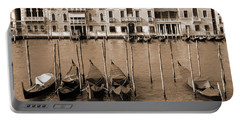 Portable Battery Charger featuring the photograph Gondolas Outside Salute by Donna Corless