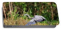 Heron Flying Along The River Bank Portable Battery Charger