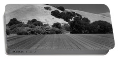 Portable Battery Charger featuring the photograph Hillside Farmland by Kathleen Grace
