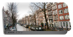 Portable Battery Charger featuring the digital art Homes Along The Canal In Amsterdam by Carol Ailles