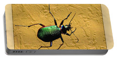 Portable Battery Charger featuring the photograph Jeweltone Beetle by Debbie Portwood