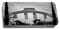 Modesto Arch With Flags Portable Battery Charger by Jim And Emily Bush