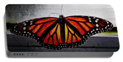 Portable Battery Charger featuring the photograph Monarch by Julia Wilcox