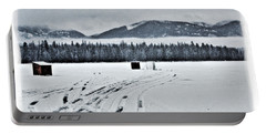 Portable Battery Charger featuring the photograph Montana Ice Fishing by Janie Johnson