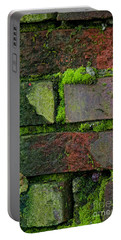 Portable Battery Charger featuring the digital art Mossy Brick Wall by Carol Ailles
