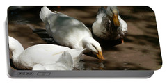 Portable Battery Charger featuring the photograph Muddy Ducks by Laurel Best