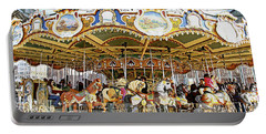 Portable Battery Charger featuring the photograph New York Carousel by Alice Gipson