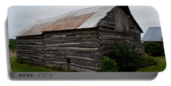 Portable Battery Charger featuring the photograph Old Log Building by Barbara McMahon