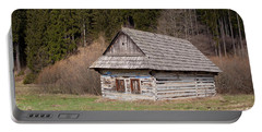 Portable Battery Charger featuring the photograph Old Log House by Les Palenik