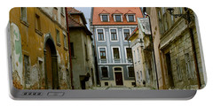 Portable Battery Charger featuring the photograph Old Street In Bratislava by Les Palenik