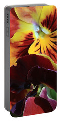 Portable Battery Charger featuring the photograph Pansies by Donna Corless