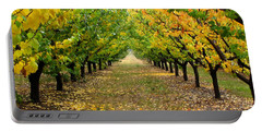 Portable Battery Charger featuring the photograph Pear Orchard by Katie Wing Vigil