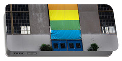 Portable Battery Charger featuring the photograph Rainbow Banner Building by Kathleen Grace