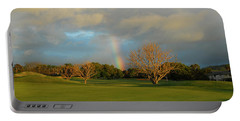 Portable Battery Charger featuring the photograph Rainbow Over Princeville by Lynn Bauer