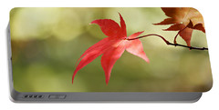 Portable Battery Charger featuring the photograph Red Leaf. by Clare Bambers