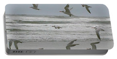 Portable Battery Charger featuring the photograph Riding The Wind by Donna Brown