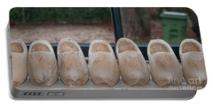 Portable Battery Charger featuring the digital art Rows Of Wooden Shoes by Carol Ailles