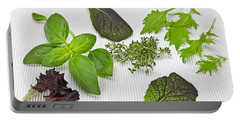 Salad Greens And Spices Portable Battery Charger by Joana Kruse