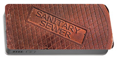 Sewer Cover Portable Battery Charger by Bill Owen