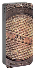 Sidewalk Gas Cover Portable Battery Charger by Bill Owen