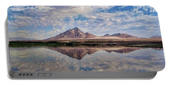 Portable Battery Charger featuring the photograph Skies Illusion by Tammy Espino