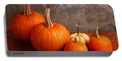 Portable Battery Charger featuring the photograph Small Decorative Pumpkins by Verena Matthew