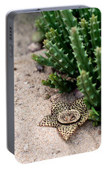 Portable Battery Charger featuring the photograph Stapelia Variegata by Laura Melis