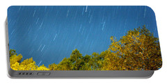 Star Trails On A Blue Sky Portable Battery Charger by Kay Lovingood