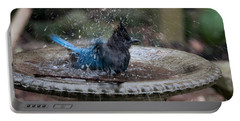 Portable Battery Charger featuring the digital art Stellar Jay In The Birdbath by Carol Ailles