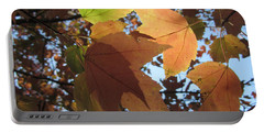 Portable Battery Charger featuring the photograph Sun-lite Fall Leaves by Donna Brown