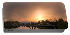 Sunburst Sunset Over Caveman Bridge Portable Battery Charger by Mick Anderson