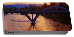 Sunset Over Caveman Bridge Portable Battery Charger by Mick Anderson