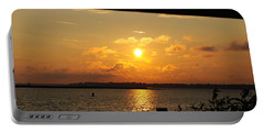 Portable Battery Charger featuring the photograph Sunset Through The Rails by Michael Frank Jr