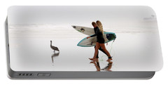Portable Battery Charger featuring the photograph Surfers And A Pelican by Alice Gipson