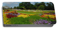 Portable Battery Charger featuring the photograph The Gardens Of The Conservatory by Lynn Bauer