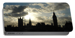 The Outline Of Big Ben And Westminster And Other Buildings At Sunset Portable Battery Charger