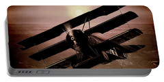 Portable Battery Charger featuring the photograph The Red Baron's Fokker At Sunset by Chris Lord