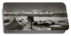 Portable Battery Charger featuring the photograph The Road Home by Eric Tressler