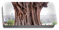 Portable Battery Charger featuring the photograph The Twisted And Gnarled Stump And Stem Of A Large Tree Inside The Qutub Minar Compound by Ashish Agarwal