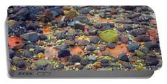 Portable Battery Charger featuring the photograph Tinopoi Beach Rocks by Mark Dodd
