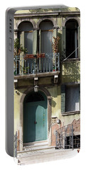 Portable Battery Charger featuring the photograph Venetian Doorway by Carla Parris