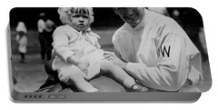 Portable Battery Charger featuring the photograph Walter Johnson Holding A Baby - C 1924 by International  Images